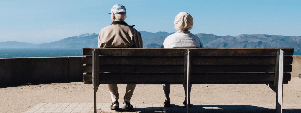 photo of Couple sitting on bench - Medicare Part B blog image