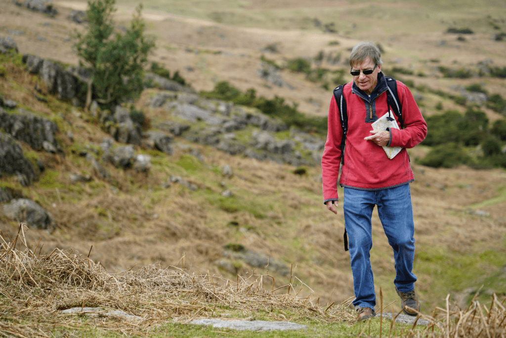 middle aged man hiking alone